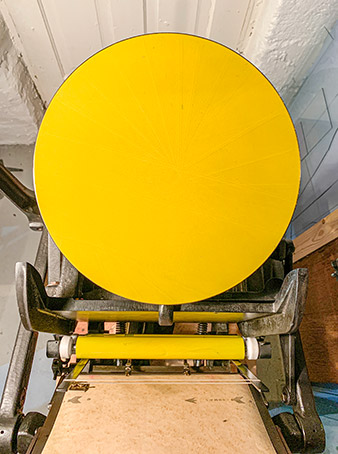 Yellow ink on the platen press